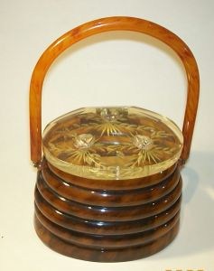 An original Llewyln 1950s Lucite Beehive Handbag with studded metal bees