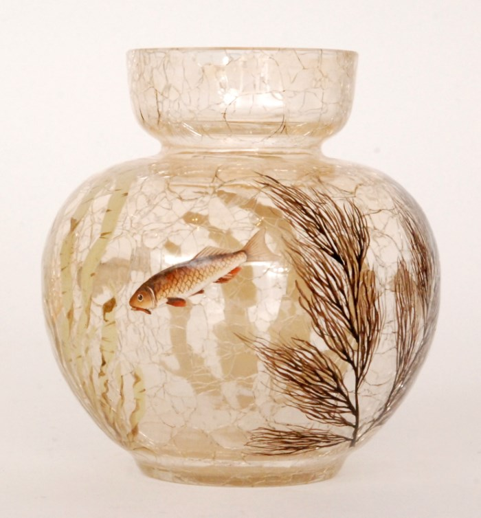 A late 19th Century Moser crackle glass vase of spherical form decorated with fish swimming amongst reeds