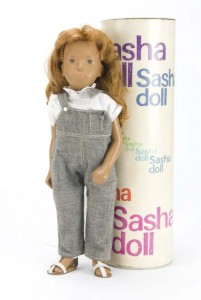 A Trendon Sasha doll with red hair grey dungarees