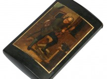 A 19th century German Stobwasser lacquered papier mache cigar case. Finely painted with the portrait of a violin player under a gilt border, named indistinct. Stamped inside the cover Stobwasser Fabrik Brunsieg, 13.25cm. Sold for £500 at Paul Beighton Auctioneers, May 2017.