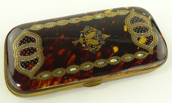 A 19th century tortoiseshell cigar case with gold and mother of pearl