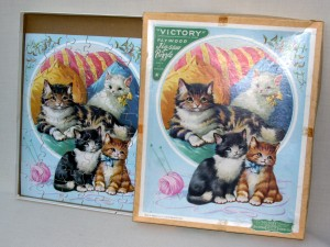 Wooden puzzle depicting a cat and kittens, 1950s, made by Victory