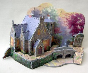 A 3-D puzzle of a Thomas Kinkade painting, 2000s, made by Gibson