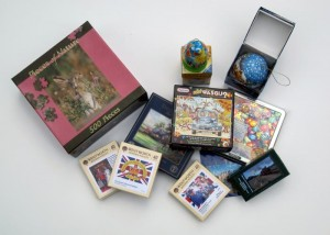 A selection of modern puzzles, including Wentworth Wooden puzzles, Wasgij, magnetic and ball puzzles