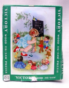 Wooden jigsaw puzzle, 1950s, child playing 'schools', made by Victory