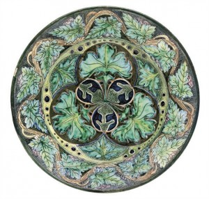 A Della Robbia Pottery Wall Plaque Decorated ByCassandia Ann Walker, Circa 1900With incised and hand painted flowers and foliage,incised monograms and manufacturer's marks 14 5/8 in. (37 cm.) diam.Sold for £1,375 ($2,284) November 2009, Christies, LondonImage Copyright Christies.