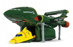 Thunderbird 2 is International Rescue's heavy equipment transporter, and is also used as the transport vehicle for the smaller Thunderbird vehicles. The craft's main pilot is Virgil Tracy, who is sometimes accompanied by back-up crew members.