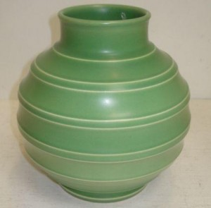 Keith Murray for Wedgwood: a green glazed bomb shape vase