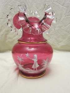 Vintage Cranberry Ruffled Vase Mary Gregory Girl With Bird. Sold for $100 (£79.91) on ebay.com December 2016.