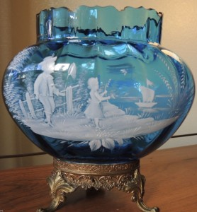 Mary Gegory blue glass vase featuring etched boy and girl by a river. Sold for $455 (£375) on ebay.com January 2017.