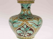 A Della Robbia Pottery Vase by Lizzie Wilkinsincised and painted with foliage no 3388incised marks, green painted LW. 13cmSold for £200 at Thomas Watson Auctioneers, Dec 2016
