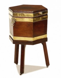 A George III brass bound mahogany wine cooler of hexagonal form the hinged lid enclosing a lead-lined interior with divisions for wine Sold at Bonhams, Knightsbridge for £1,062 inc. premium, Feb 2012