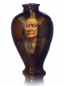 A Rookwood Pottery Rushing Eagle vase 1898 Sturgis Laurence (1870-1961) of baluster form with square foot and neck, painted with a softly illuminated portrait of a Native American Indian Sioux chief named 'Rushing Eagle', against a rich dark brown glaze 27.5cm high, impressed Rookwood mark, with incised title artist's signature and date Sold for £1,550 at Bonhams, London, June, 2015.