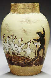 Maria Longworth Nichols and Albert R. Valentien Earthenware Vase for Rookwood, 1883. In the dull finish, decorated with a frog conducting a choir of ducks amidst Oriental grasses, chased around the neck and foot with a fire-on-gold honeycomb motif signed in gilt MLN, incised A.R.V. and impressed Rookwood 1883 Y 162 with the kiln and anchor mark, and with remnants of paper label. Sold for $9,400 at Christies, New York, 2001.