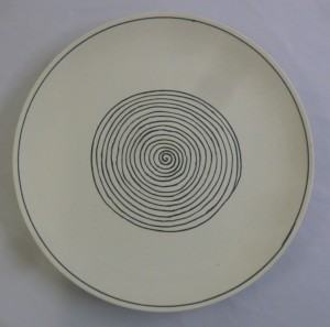 A Susie Cooper charger with black spiral decoration dated 1937