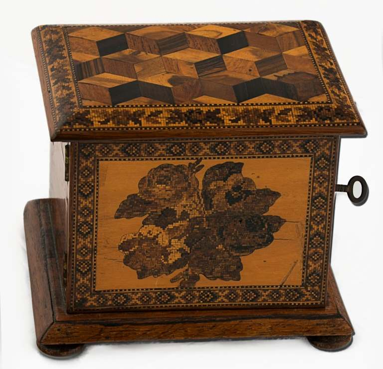 A 19th century Tunbridge ware table cabinet, decorated with tumbling cube and floral sprays