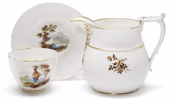 A rare Swansea jug and a teacup and saucer circa 1815-17