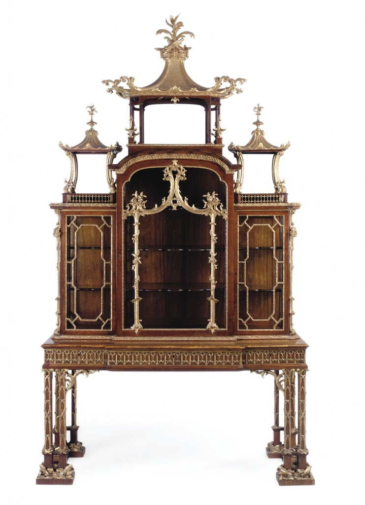 A George II parcel-gilt padouk cabinet-on-stand, attributed to Thomas Chippendale