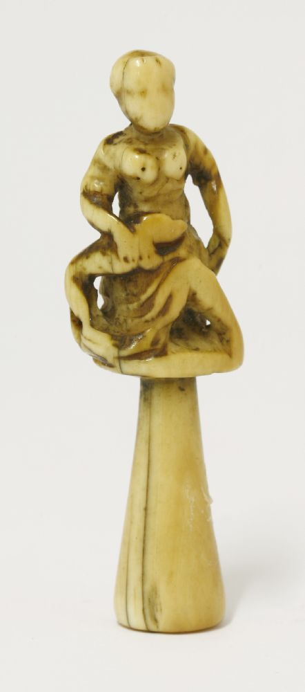An ivory tobacco stopper probably 18th century depicting a lady and a hound