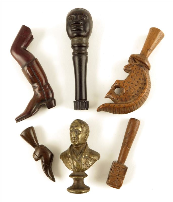 A collection of tobacco stoppers tobacco tampers