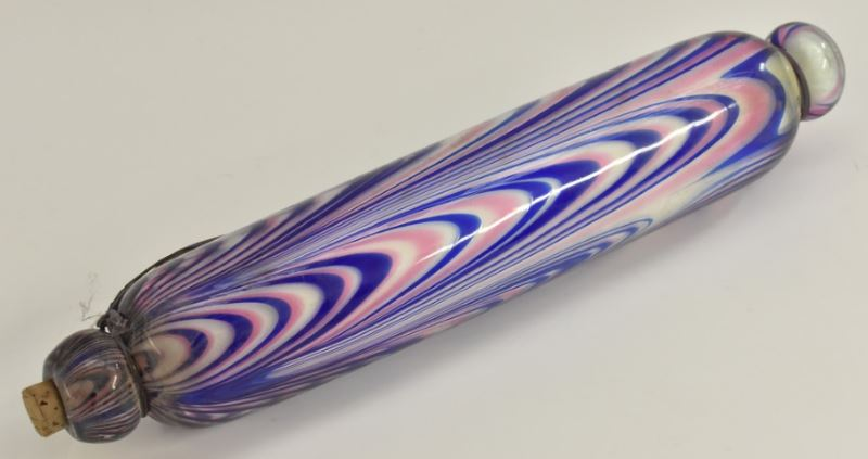 A Nailsea glass rolling pin in pink blue and white