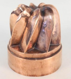 A large Victorian circular copper jelly mould having eight angled and swirled turrets