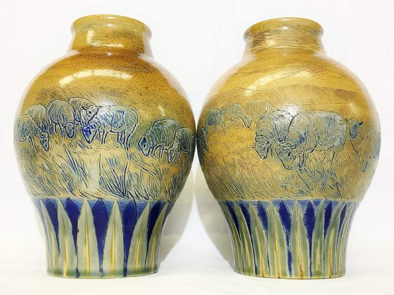 A pair of rounded Royal Doulton vases by Hannah Barlow featuring sheep design