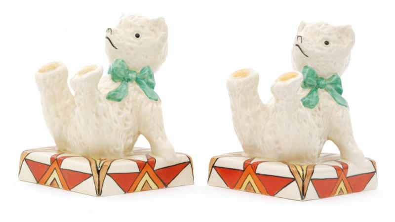 A pair of novelty Clarice Cliff bookends circa 1930 in Sunburst pattern