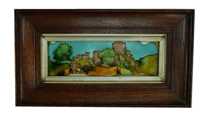 A rare Charlotte Rhead tile tube lined with Conway Castle in oak frame