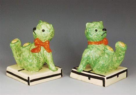 Clarice Cliff teddy bear bookends in green form with orange bows